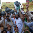 Stock Photo: Activists of Muslim League-N chant slogans against distribution of party tickets during protest demonstration