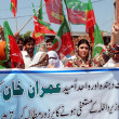 Stock Photo: Activists of Tehreek-e-Insaf (WomWing) chant slogans in favor of PTI ChairmImrKhduring protest demonstration