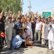 Stock Photo: Activists of Muslim League-N chant slogans against distribution of party ticket during protest demonstration at Lahore press club