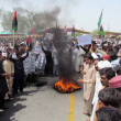 Stock Photo: Activists of Peoples Party (PPP) burn tyres blocked National Highway as they are protesting against election commission officials