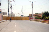 The road leads toward MQM Secretariat Nine Zero seen closed due to security concerns after dual bomb blast at election camp office of the party — Stock Photo