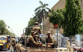 Army personnel convoy patrol in city for maintain law and order situation for upcoming General Election 2013 — Stockfoto