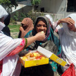 Stock Photo: Activists of Muslim League-N are distributing sweetmeats on their party success in general elections