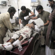 Paramedical staff being treated an injured of two blasts that hit two mosque before Friday prayer, at Lady Reading Hospital in Peshawar - Stock Photo