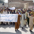 Members of ChamCitizen Action Committee chant slogans against kidnapping of senior Doctor Mubashir Hussain and demanding to his recovery immediately — Stock Photo #25696677
