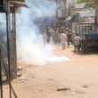 Police officials fire tear-gas shells to disperse protesters during protest demonstration of residents of Lyari against increasing incidents of targeted killings in the area — Stock Photo