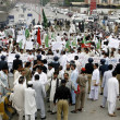 Residents of Bannu District chant slogans against alleged rigging in general election in their areduring protest demonstration at Jail road — Stock Photo #25944061