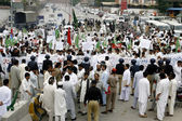 Residents of Bannu District chant slogans against alleged rigging in general election in their area during protest demonstration at Jail road — Stock Photo