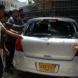 Stock Photo: Gather near car of Engineer Mohsin RazAbidi who was assassinated by unidentified gunmen at Nazimabad area