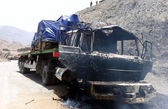 View of burnt truck after an attack as the NATO Supply convoy heading to Afghanistan came under attack in the Jamrud area in the Khyber tribal region — Stock Photo