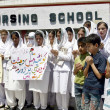 Paramedical Staffs of Khyber Teaching Hospital are protesting against the killing of innocent in two bomb blasts at Sardar Bahadur Khan Women University in Quetta — Stock Photo