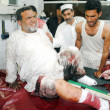 Victim of suicide bomb blast at Shergarh area of Mardan being admitted for treatment at Lady Reading hospital, in Peshawar on Tuesday, June 18, 2013. At least Twenty-eight were killed — Stock Photo #26936255