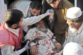 Victim of suicide bomb blast at Shergarh area of Mardan being shifted to Lady Reading hospital, in Peshawar on Tuesday, June 18, 2013. At least Twenty-eight were killed — Stock Photo