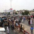 Постер, плакат: Residents of Hazara Colony are protesting against murder of their relatives as they blocked Korangi Road