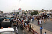 Residents of Hazara Colony are protesting against murder of their relatives as they blocked Korangi Road — Stock Photo