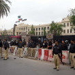 Security officials stand alert to avoid untoward incident during protest demonstration of residents of Lyari against operations conducted by rangers and security personnel in their area — Stock Photo #27518081