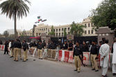 Security officials stand alert to avoid untoward incident during protest demonstration of residents of Lyari against operations conducted by rangers and security personnel in their area — Stock Photo