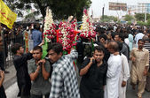Shiite mourners touch Ziarat respectfully during mourning procession in connection of Youm-e-Ali (A.S), the martyrdom day of Hazrat Ali (A.S) — Stock Photo