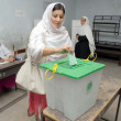 Stock Photo: Voters cast their votes at a polling station during by-election for NA-01 in Peshawar