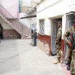 Security officials stand alert to avoid untoward incidents at a polling station during by-election for PS-95 at Orangi area in Karachi — Stock Photo #30216879