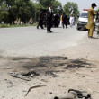 Security officials stand alert at the site after a remote controlled blast at Kohat Road when the convoy of security forces was passing through the Bazid Khel area — Stock Photo