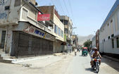 Shops are seen closed during shutter down strike called by Jamhoori Watan Party on occasion of seventh death anniversary of Bugti tribe leader, Nawab Akbar Bugti — Stock Photo