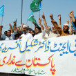 Supporters of Jamat-e-Islami (JI) chant slogans against Dr Shakeel Afridi, mwho helped CItrack down OsamBin Laden — Stock Photo #30604239