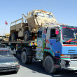 Постер, плакат: Levis forces officials stand alert in the squad trucks which were carrying US military equipments coming from Kandahar crossing Pak Afghan border towards for Karachi port