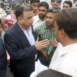Постер, плакат: Muttahida Qaumi Movement leader Babar Ghauri talks to protesters who were protesting against non merit recruitment in police department on the rank of constable