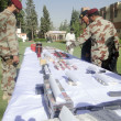 Постер, плакат: Balochistan Frontier Corps Inspector General Major General Muhammad Ejaz Shahid inspects seized explosives material and weapons that were recovered by FC officials