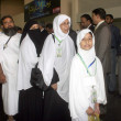 Pakistani pilgrims stand in a queue at Jinnah International Airport Hajj Terminal to board first flight to leave for Jeddah, as they departure for the Annual Hajj pilgrimage in Saudi Arabia — Stock Photo