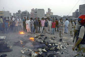 Residents of Line Area are protesting against excessive load shedding of electricity as they torched fire and blocked the road during protest demonstration — Stock Photo