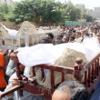 People carry coffin of Zafar Baloch, a prominent leader of the banned Peoples Aman Committee and his bodyguard Ghani Baloch, who were killed on Wednesday night — Stock Photo