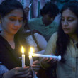 Members of Christian Unity Forum are lightning candles during a protest demonstration against dual suicidal bomb blast attack on a church of Peshawar — Stock Photo