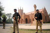 Security officials standing alert as the security of churches has been tightening after dual suicidal bomb blast attack on a church of Kohati Gate, at Saints Jones Church — Stock Photo