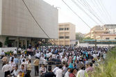 People gather on roads in panic following an earthquake shook, in Karachi on Tuesday — Stock Photo