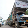 Trucks loaded with relief goods, donated by Khyber Pakhtunkhwa Chief Minister, stand ready for dispatch to earthquake hit areas of Balochistan — Stock Photo
