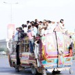 Stock Photo: Passengers travelling on overloaded bus as short of public transport is being observed due to closure of CNG Stations