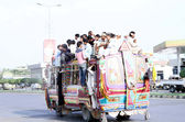 Passengers travelling on an overloaded bus as the short of public transport is being observed due to closure of CNG Stations — Stock Photo