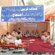 Stock Photo: Members of Doctors Community are sitting on demonstration camp against abduction of Dr. Munaf Tareen