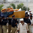 Stock Photo: Police officials carry coffin of security personals, who killed in bomb explosion near hospital at Sulemankhel of Badaber area