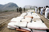 Security officials inspect recovered 6578 kg packets of drug (Charas), which were seized during operation in Bara area, during press conference — Stock Photo