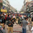 Police, rescues officials and people busy in rescue work at the site after strong bomb explosion outside a Biryani restaurant at the Old Anarkali area — Stock Photo
