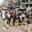 Police, rescues officials and people busy in rescue work at the site after strong bomb explosion outside a Biryani restaurant — Stock Photo #33075465