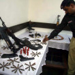 Police officials showing recovered weapon during a raid in connection of peace impose on arrival of Moharram-ul-Haram — Stock Photo