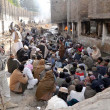 Постер, плакат: Anti Narcotics Forces officials arrest a large number of drug addicts during a search operation at City Nala area near Jinnah road in Quetta