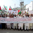 Stock Photo: Activists of Sunni Action Committee chant slogans against sectariclashes in Rawalpindi on Ashurprocession during protest demonstration