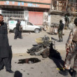 Security and rescues officials gather at the site after a powerful blast occurred near Sarki Road in Quetta — Stok fotoğraf