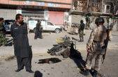 Security and rescues officials gather at the site after a powerful blast occurred near Sarki Road in Quetta — Stock Photo