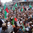Постер, плакат: Leaders and activists of Ahle Sunnat Wal Jamat chant slogans against sectarian clashes in Rawalpindi